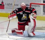 Jared Coreau stretches in his crease at the start of the second period of a Grand Rapids Griffins playoff game.
