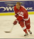 Tomas Holmstrom follows through on a shot from the right circle during pregame warmups before a preseason game.