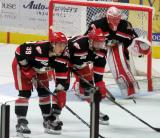 Tyler Bertuzzi, Brian Lashoff, and Jared Coreau get set for a faceoff during a Grand Rapids Griffins playoff game.