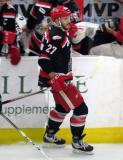 Martin Frk gives fist-bumps to the bench after scoring a goal in a Grand Rapids Griffins playoff game.