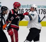 Dylan McIlrath scuffles with Kevin Labanc of the San Jose Barracuda during a Grand Rapids Griffins playoff game.