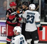 Robbie Russo has to be separated from Barclay Goodrow of the San Jose Barracuda during a Grand Rapids Griffins playoff game.