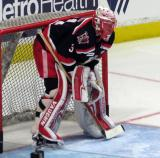 Jared Coreau crouches in his crease during pre-game warmups before a Grand Rapids Griffins Calder Cup Finals game.