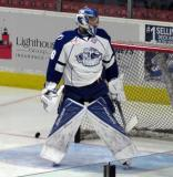 Mike McKenna of the Syracuse Crunch stands in his crease during pre-game warmups before a Calder Cup Finals game against the Grand Rapids Griffins.