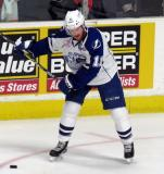 Erik Condra of the Syracuse Crunch takes a shot during pre-game warmups before a Calder Cup Finals game against the Grand Rapids Griffins.