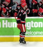 Nathan Paetsch gives fist-bumps to the bench after scoring a goal during a Grand Rapids Griffins Calder Cup Finals game.