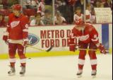 Henrik Zetterberg and Tomas Kopecky stand near the far boards during pregame warmups before a preseason game.