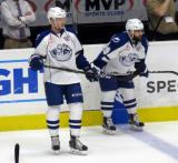 Joel Vermin and Cory Conacher of the Syracuse Crunch stand near the bench during pre-game warmups before Game Six of the Calder Cup Finals against the Grand Rapids Griffins.