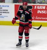 Dominic Turgeon stands near the boards during pre-game warmups before Game Six of the Calder Cup Finals between the Grand Rapids Griffins and Syracuse Crunch.