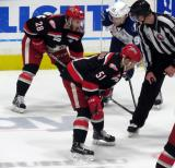Kyle Criscuolo gets set for a faceoff with Matt Lorito on his wing and Joel Vermin opposite him during Game Six of the Calder Cup Finals between the Grand Rapids Griffins and Syracuse Crunch.