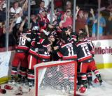 The Grand Rapids Griffins come together at the end boards to celebrate their Calder Cup Championship.