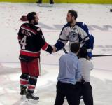 Nathan Paetsch shakes hands with Jake Dotchin of the Syracuse Crunch following the Grand Rapids Griffins' Calder Cup Championship.