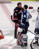 Jared Coreau shakes hands with Jake Dotchin of the Syracuse Crunch following the Grand Rapids Griffins' Calder Cup Championship.