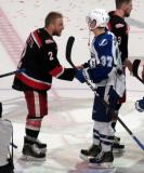 Joe Hicketts shakes hands with Yanni Gourde of the Syracuse Crunch following the Grand Rapids Griffins' Calder Cup Championship.
