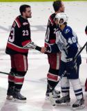 Dominic Turgeon shakes hands with Gabriel Dumont of the Syracuse Crunch following the Grand Rapids Griffins' Calder Cup Championship.