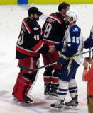 Eddie Pasquale shakes hands with Kevin Lynch of the Syracuse Crunch following the Grand Rapids Griffins' Calder Cup Championship.