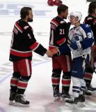 Axel Holmstrom shakes hands with Yanni Gourde of the Syracuse Crunch following the Grand Rapids Griffins' Calder Cup Championship.