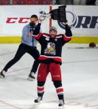 Ben Street skates with the Calder Cup.