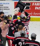 Ben Street hands the Calder Cup off to Eric Tangradi.