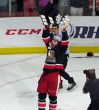 Eric Tangradi skates with the Calder Cup.