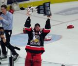 Brian Lashoff skates with the Calder Cup.