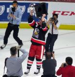 Mitch Callahan skates with the Calder Cup.