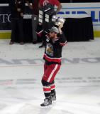 Dylan McIlrath skates with the Calder Cup.
