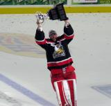Jared Coreau skates with the Calder Cup.