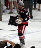 Colin Campbell carries the Calder Cup.