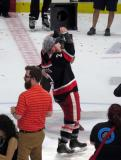 Joe Hicketts skates with the Calder Cup.