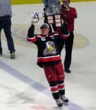 Kyle Criscuolo skates with the Calder Cup.