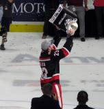 Dominic Turgeon skates with the Calder Cup.