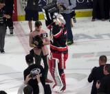 Eddie Pasquale skates with the Calder Cup.