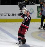 Dan Renouf skates with the Calder Cup.