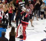 Cal Heeter skates with the Calder Cup.