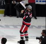 Axel Holmstrom skates with the Calder Cup.