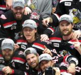 Matt Ford, Brian Lashoff, Tyler Bertuzzi, Colin Campbell, and Dylan McIlrath pose for the Grand Rapids Griffins' team picture with the Calder Cup.