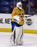 Filip Larsson of Team Sweden skates to the bench at the end of the first period of a game against Team Finland in the 2017 World Junior Summer Showcase.