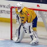 Filip Larsson of Team Sweden gets set in his crease at the start of the second period of a game against Team Finland in the 2017 World Junior Summer Showcase.