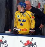 Tim Soderlund of Team Sweden stands at the bench during a game against Team Finland in the 2017 World Junior Summer Showcase.