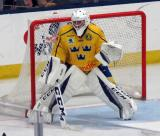 Filip Larsson of Team Sweden gets set in his crease during a game against Team Finland in the 2017 World Junior Summer Showcase.
