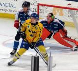 Kasper Kotkansalo and Ukko-Pekka Luukkonen of Team Finland defend against Marcus Davidsson of Team Sweden in the 2017 World Junior Summer Showcase.