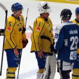 Gustav Lindstrom and Filip Larsson of Team Sweden shake hands with Juuso Valimaki of Team Finland after a game in the 2017 World Junior Summer Showcase.