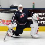 Joseph Woll of Team USA stretches near the boards before a game against Team Canada at the 2017 World Junior Summer Showcase.