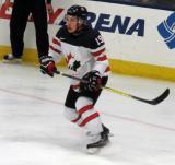 Tanner Kaspick of Team Canada skates near the end boards during a game against Team USA at the 2017 World Junior Summer Showcase.