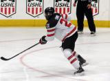 Givani Smith of Team Canada skates up the ice during a game against Team USA at the 2017 World Junior Summer Showcase.
