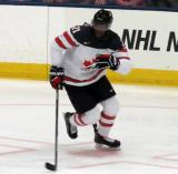 Givani Smith of Team Canada skates during a game against Team USA at the 2017 World Junior Summer Showcase.