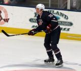 Andrew Peeke of Team USA skates near the boards during a game against Team Canada at the 2017 World Junior Summer Showcase.