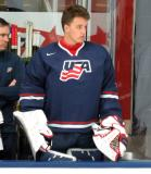 Backup goalie Jake Oettinger of Team USA stands at the bench during a game against Team Canada at the 2017 World Junior Summer Showcase.