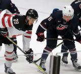 Brett Howden of Team Canada lines up opposite Casey Mittelstadt of Team USA on a faceoff during a game at the 2017 World Junior Summer Showcase.